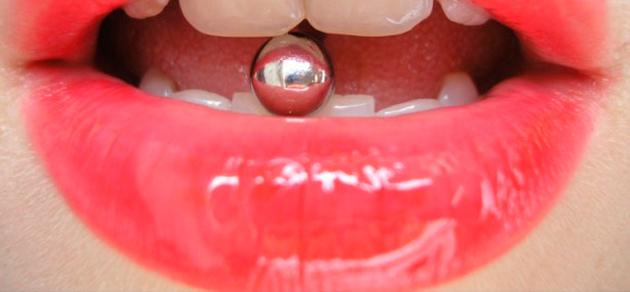 Боль и другие проблемы во время и после пирсинга языка